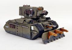 "DaveTaylorMinis.com.""Vostrayan"" KV-2 Pattern ""Ragnarok"" Demolisher. Wargear: main/turret demolisher siege-gun; front/hull & 2x sub/turrets w/ lascannon/2x heavy-bolters; dozer-blade; side-skirts/extra-armour."