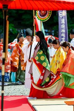 Men and women dressed in heian robes for the Mifune festival.