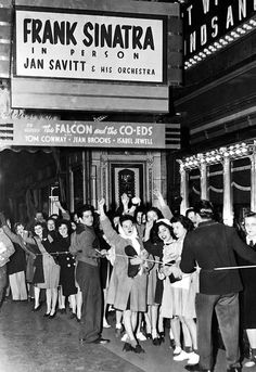 Frank Sinatra live on stage while on screen Tom Conway and Jean Brooks star in THE FALCON AND THE CO-ED - Theater unknown.
