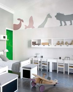 Don't know how I feel about the lime green or the excessive amount of white for a kids room... But the decals are awesome! And I love the chests at the end of the bed!