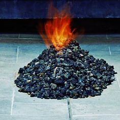 For a tropical look in your own backyard, try this novel firepit design—lava stone mounded volcano-style around a central gas jet. via Sunset.com