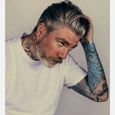 Pin for Later: 20 Shades of Hot Gray-Haired Guys All Tatted Up