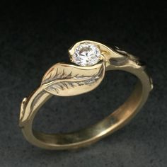My engagement ring, although mine is white gold. DELICATE TWO-LEAF Ring, made in either yellow gold, or white gold, Set With White Sapphire Jewelry Box, Jewelery, Jewelry Accessories, Jewelry Design, Leaf Ring, Twig Ring, White Sapphire, Sapphire Rings, Wedding Rings