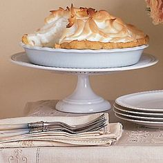 scissors or a sharp knife, trim the dough so it overhangs the tin by about 1 inch. Turn overhanging dough under, forming a rim, and crimp the edges of the pastry. Lightly prick the bottom of the dough with a fork; brush the rim with Coconut Custard, Coconut Cream, Double Coconut, Custard Filling, Classic Desserts, Dried Beans, Toasted Coconut, Cream Pie, Pie Recipes