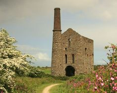 A tin mine on the Mineral Tramway cycle route, part of Cornwall's historic mining heritage. Cornish Tin Mines, Cycle Route, Engine House, Devon And Cornwall, Ancient Ruins, Days Out, Mineral, Monument Valley, Ireland