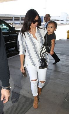 Kim Kardashian and north west- like Kim outfit, but don't like the way she dresses her daughter :/