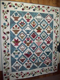 Appliqued and pieced basket blocks in a quilt set on point from Cottons 'n Wool