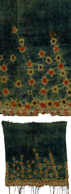 Africa | Veil from Tunisia | Wool; with orange and red tie-dyed flowers on a faded indigo background, a fringe to one end