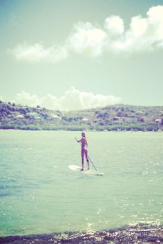 Candice Swanepoel morning paddle board
