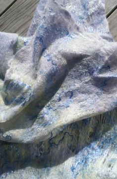 Cobweb felted wrap in alpaca with bamboo and silk additions. Super soft to the touch. Like gossamer. By pocketdelight.