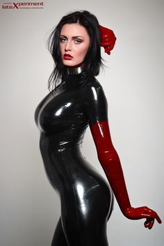 Grace stout black and red - Grace Stout is a fashion model and the tallest latex girl in Germany who loves also fetish art. She likes the idea to combine latex with fashion in the Highstyle area but she also likes the idea to be dressed totally in latex and wears sometimes a mask. The feeling of being completely dressed in latex from head to toe inspires her. She wears a permanent stainless steel collar.