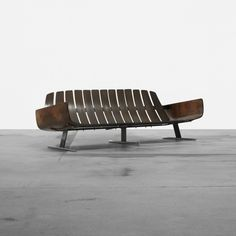 Jorge Zalszupin sofa Brazil, c. 1970 rosewood plywood, enameled steel, chrome-plated steel 77 w x 29 d x 25.5 h inches