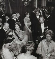 Prince Henry, the Duke of Gloucester, Princess Alice, the Duchess of Gloucester, Queen Elizabeth II, the Queen Mother, probably Princess Mary, the Countess of Harewood, Queen Frederica and King Paul of Greece.