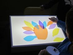 Exploring turkeys, shapes, and colors on the light table. We could do this for any animal. We could also stick with circles, squares, and triangles and let them come up with their own designs. Light Up Box, Light Board, Fall Activities For Toddlers, Autumn Activities, Thanksgiving Projects, Thanksgiving Preschool, Sensory Lights, Teach Preschool, Sensory Boxes