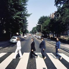 An outtake from the Abbey Road cover shoot - The Beatles (Notice Paul is wearing sandals in this shot) So much better bare foot!