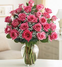 Ultimate Elegance™ Premium Long Stem Pink Roses - The freshest premium long-stem pink roses, hand-designed by our expert florists with gypsophila in a stylish clear glass vase $119.99- $209.99 #pinkroses #rosebouquet