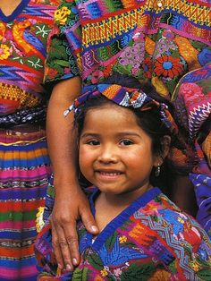 True Mayan heritage: Colorful textiles and a warm soul. Girl from #Guatemala...