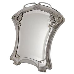 Silvered Art Nouveau mirror by Orivit beveled glass, Germany 1904.   From a unique collection of antique and modern table mirrors at https://www.1stdibs.com/furniture/mirrors/table-mirrors/