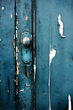 Rustic painted teal door...