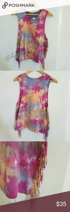 NWT LF Emma & Sam Tie Dyed Fringe Boho Hippie Top Brand new with tags. Trippy tie-dye sleeveless top with fringe accents on the sides. Each one has a unique design (as seen by the differences in last pic). Magenta, blue/purple, & orange. Great as festival ware. 100% Supima cotton. Sz XS. By Emma & Sam. Retailed for $138 at LF.  Please check out my closet for more NWT LF items to bundle with discount and save more with combined shipping. LF Tops Tank Tops