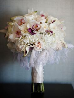 Another cool bouquet with White ostrich feathers around the collar and Roses, hydrangea, cymbidium orchids and mini calla lilies! Orchid Bridal Bouquets, Feather Bouquet, Floral Bouquets, Wedding Bouquets, Bouquet Flowers, Boutonnieres, Flower Centerpieces, Flower Arrangements, Wedding Centerpieces