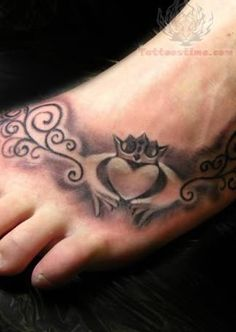 an irish tattoo. I like the idea of the claddagh. I would like this one better without the shadowing and the ornate vines. small and more simple.