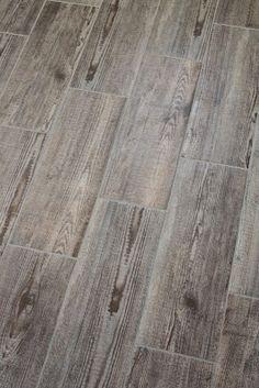 happenstance home: Bathroom Update - Ceramic tiles that look like old wood.