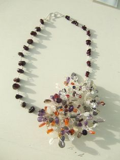 Beautiful multigem and garnet corsage by blueladybird designs Ornament Wreath, Corsage, Garnet, Gems, Wreaths, Trending Outfits, Unique Jewelry, Handmade Gifts, Vintage