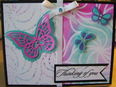 Judikins stencil, Distress Inks.  The right side is the inked image for the left side I spritzed the inked stencil with water and laid the cardstock on top.  HOTP die