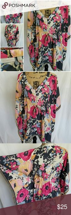 Attention Grabber!!! Gorgeous Floral Kimono This one will knock their socks off! No flaws, very nice material. New York & Company, great quality piece! New York & Company Tops Tunics