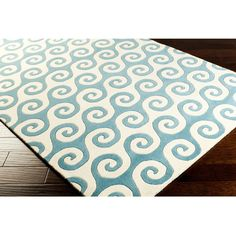 Add a coastal feel to decor with this transitional Oceana rug. Hand-tufted with wool, the rug features an abstract design in neutral colors that complement any space.