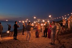 Sparklers for when the sun goes down! (String lights extend from the reception tent down to the water to the recreation area with bonfire/sparklers)