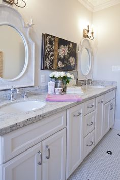 For granite - She used white river granite both in the bathrooms and the kitchen.  Looks beautiful when paired with white cabinetry.