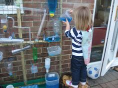 Great idea for water wall - wood frame with fencing over it!  Zip ties make it simple.