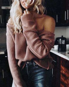 Rose off the shoulder sweater with black leather pants.