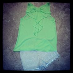 Neon green bow back top with cream lace shorts. Both available for purchase