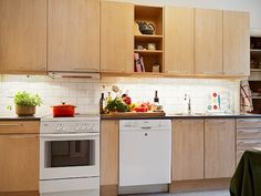 birch cabinets white appliances white subway tile backsplash