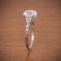 A rare Edwardian Engagement Ring, circa 1910. The old European cut diamond is 2.06ct, J color and VS2 clarity. Fine filigree and milgrain