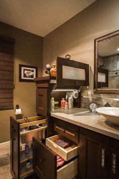 16 DIY Extra Storage Items For Small Bathrooms Appliance garage in the bathroom? Brilliant!
