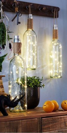 Creative Farmhouse: Wine Bottle DIY Rustic Lanterns for your home or patio decoratind. Country Home Decor Ideas Maison - Décoration à LED Bouteille de vin #farmhousedecor #countryhomedecorideas #DIYHomeDecorWineBottles #homedecordiyideas