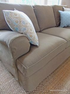 Custom made denim slipcover in color Burlap... a smart solution for protecting upholstery from the dogs!