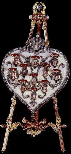 The heart is surmounted with the Imperial crown, and carries eleven scarlet medallions decorated with the monograms of the members of the Imperial family.