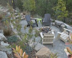 Sloped Backyard Design, stone retaining wall, fire-pit, landscape