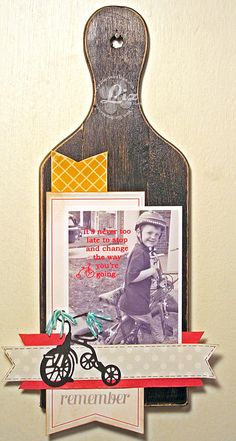 Liz -  Using a repurposed cutting board for home decor, embellished with a Die-Versions die - how cute is this??  I love the baker's twine streamers on the handlebars!