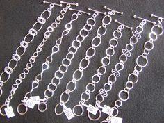 Hand forged sterling silver bracelets by DenaJonesDesigns.com