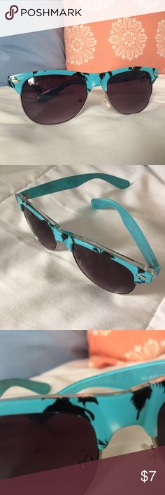 Wet Seal Sunglasses Wet Seal Sunglasses. Blue with black palm trees. Good Condition with some faded spots as seen in photos. Smoke-free home! Wet Seal Accessories Sunglasses