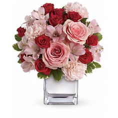Luscious is the word to describe this gorgeous bouquet of red and pink #roses and other #romantic favorites in a chic mirrored silver cube. It's simple and simply spectacular. Many #Valentine2k17 kisses are in order.