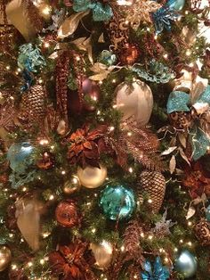Bronze, gold, turquoise - Christmas - The prettiest tree decorations in downtown Houston. Love the browns with the turquoise!  http://schwartzandstuffacraftblog.blogspot.com/2012/11/ive-enjoy-working-in-downtown-houston.html