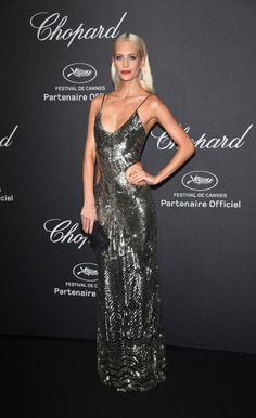 It's the most glamorous red carpet of the year: Cannes Film Festival. Poppy Delevingne stuns in a metallic sparkling gown and bold red lip. See all the best red carpet looks from Cannes 2016 here: