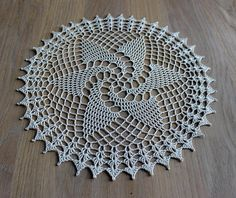 Large round crochet doily in ivory. Made with quality mercerized crochet cotton. Starched for stiffness and shape. 28cm (11) in diameter. I have a variety of crochet doilies available for sale- please see my other items. All crochet doilies that I sell are new and have been hand made